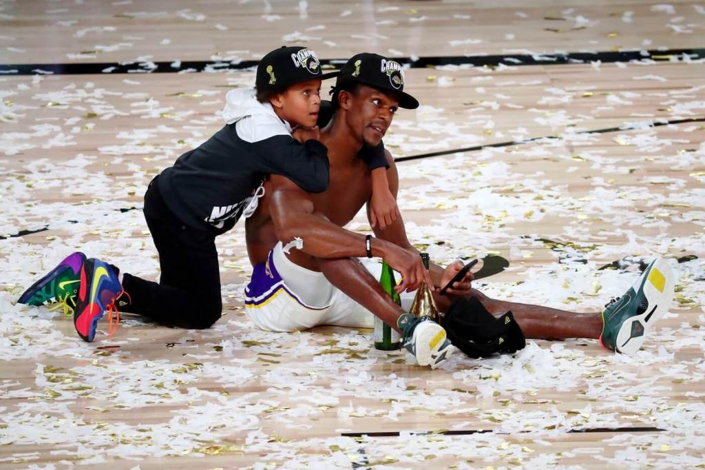 Oct 11, 2020; Lake Buena Vista, Florida, USA; Los Angeles Lakers guard Rajon Rondo (9) sits on the court with his son after game six of the 2020 NBA Finals at AdventHealth Arena. The Los Angeles Lakers won 106-93 to win the series. Mandatory Credit: Kim Klement-USA TODAY Sports