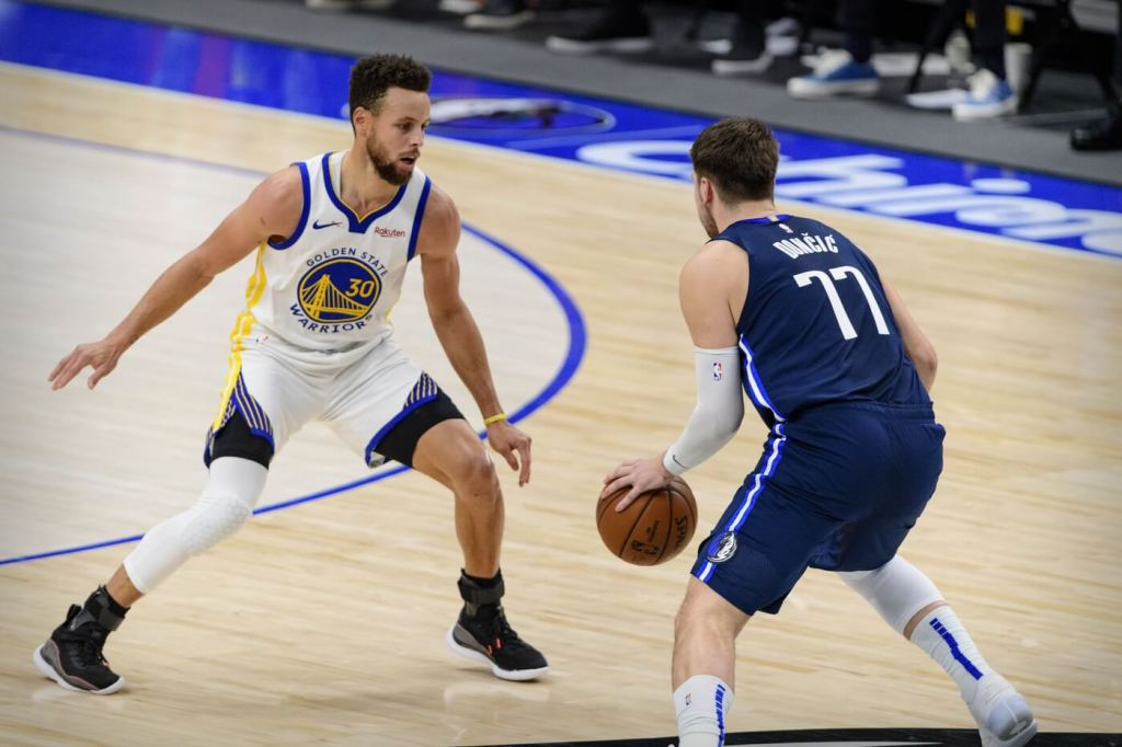 Feb 6, 2021; Dallas, Texas, USA; Golden State Warriors guard Stephen Curry (30) and Dallas Mavericks guard Luka Doncic (77) in action during the game between the Dallas Mavericks and the Golden State Warriors at the American Airlines Center. Mandatory Credit: Jerome Miron-USA TODAY Sports