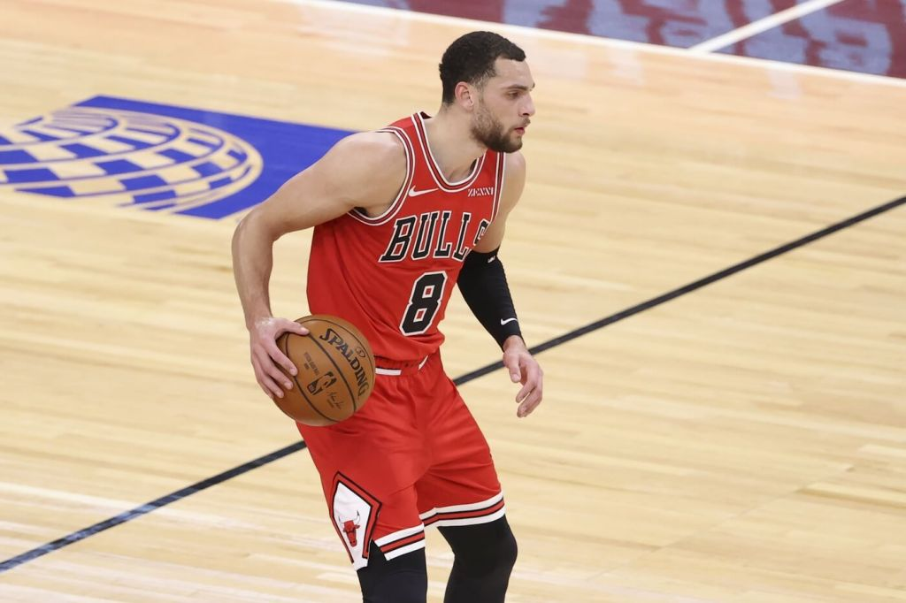 Feb 1, 2021; Chicago, Illinois, USA; Chicago Bulls guard Zach LaVine (8) looks to pass the ball against the New York Knicks during the first half of an NBA game at United Center. Mandatory Credit: Kamil Krzaczynski-USA TODAY Sports