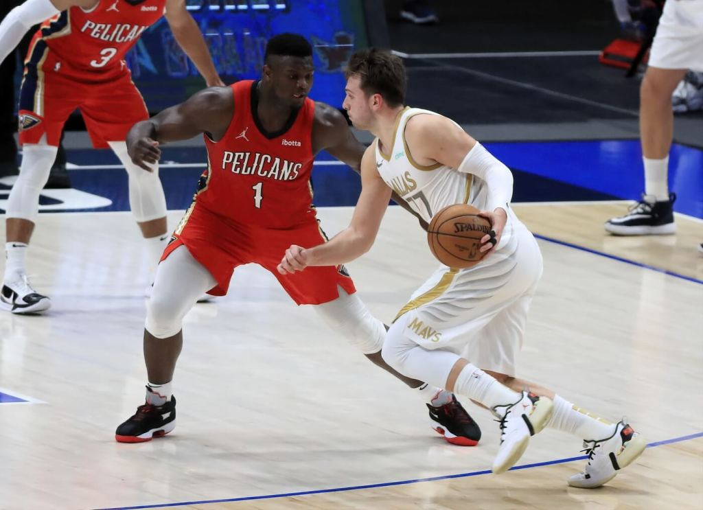 Feb 12, 2021; Dallas, Texas, USA; Dallas Mavericks guard Luka Doncic (77) drives to the basket as New Orleans Pelicans forward Zion Williamson (1) defends during the second half at American Airlines Center. Mandatory Credit: Kevin Jairaj-USA TODAY Sports