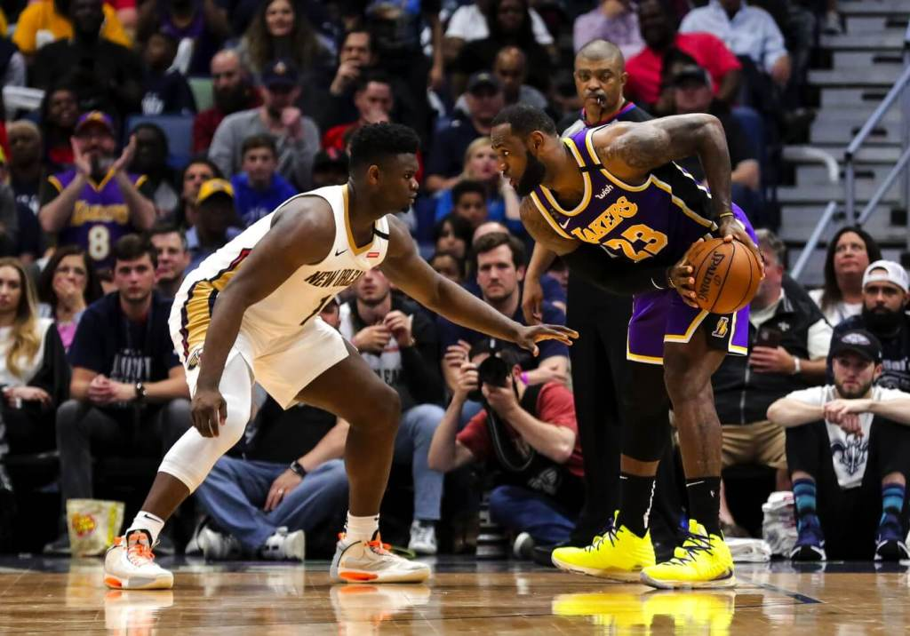 Mar 1, 2020; New Orleans, Louisiana, USA; New Orleans Pelicans forward Zion Williamson (1) defends against Los Angeles Lakers forward LeBron James (23) during the fourth quarter at the Smoothie King Center. Mandatory Credit: Derick E. Hingle-USA TODAY Sports
