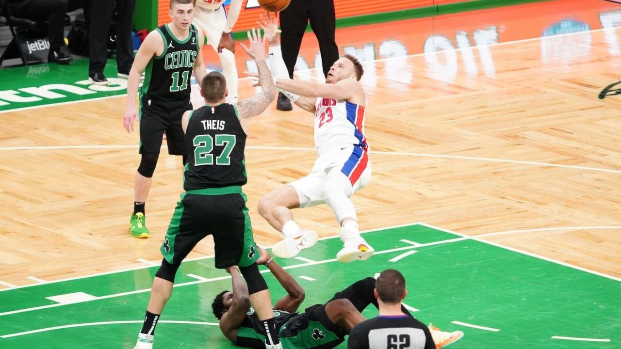 Feb 12, 2021; Boston, Massachusetts, USA; Detroit Pistons forward Blake Griffin (23) shoots as he is fouled by Boston Celtics forward Semi Ojeleye (37) in the third quarter at TD Garden. Mandatory Credit: David Butler II-USA TODAY Sports