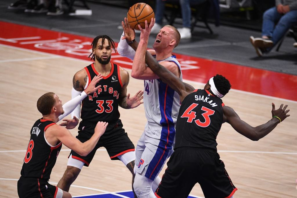 Mar 29, 2021; Detroit, Michigan, USA; Detroit Pistons center Mason Plumlee (24) is fouled by Toronto Raptors forward Pascal Siakam (43) during the second quarter at Little Caesars Arena. Mandatory Credit: Tim Fuller-USA TODAY Sports