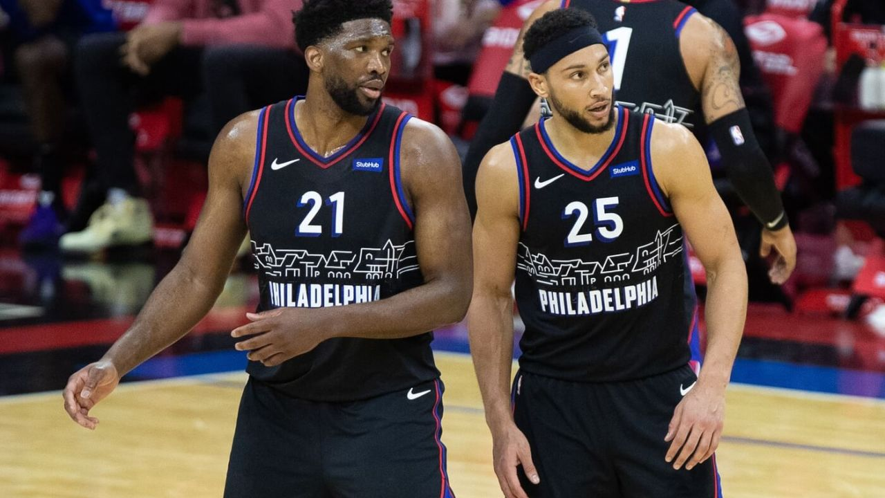 Feb 27, 2021; Philadelphia, Pennsylvania, USA; Philadelphia 76ers guard Ben Simmons (25) and center Joel Embiid (21) look on during the third quarter against the Cleveland Cavaliers at Wells Fargo Center. Mandatory Credit: Bill Streicher-USA TODAY Sports