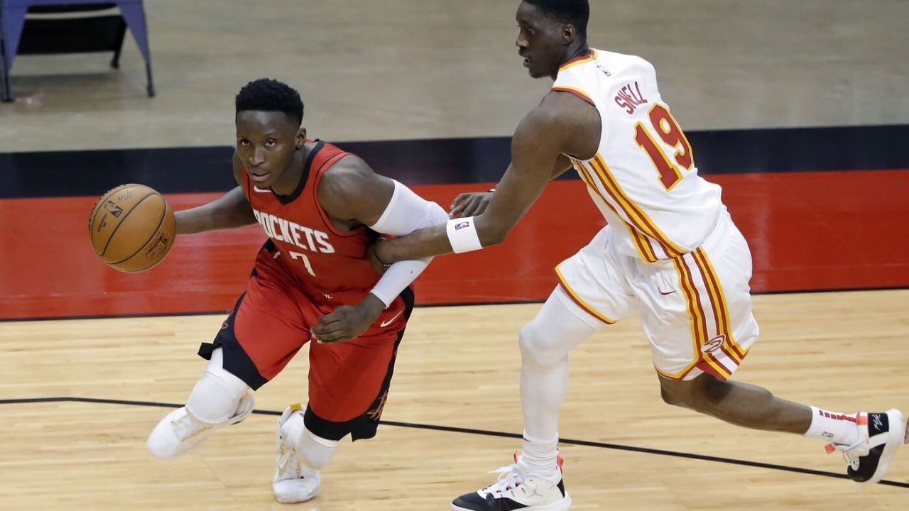 Mar 16, 2021; Houston, Texas, USA; Houston Rockets guard Victor Oladipo (7) is fouled as he drives around Atlanta Hawks guard Tony Snell (19) during the second half at Toyota Center. Mandatory Credit: Michael Wyke/POOL PHOTOS-USA TODAY Sports