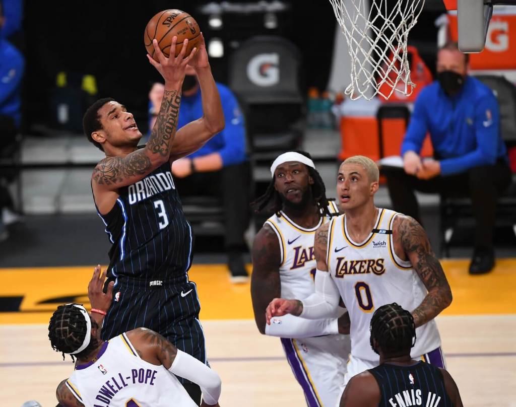 Mar 28, 2021; Los Angeles, California, USA; Orlando Magic forward Chuma Okeke (3) shoots over Los Angeles Lakers center Montrezl Harrell (15) and forward Kyle Kuzma (0) for a basket in the second half at Staples Center. Mandatory Credit: Jayne Kamin-Oncea-USA TODAY Sports