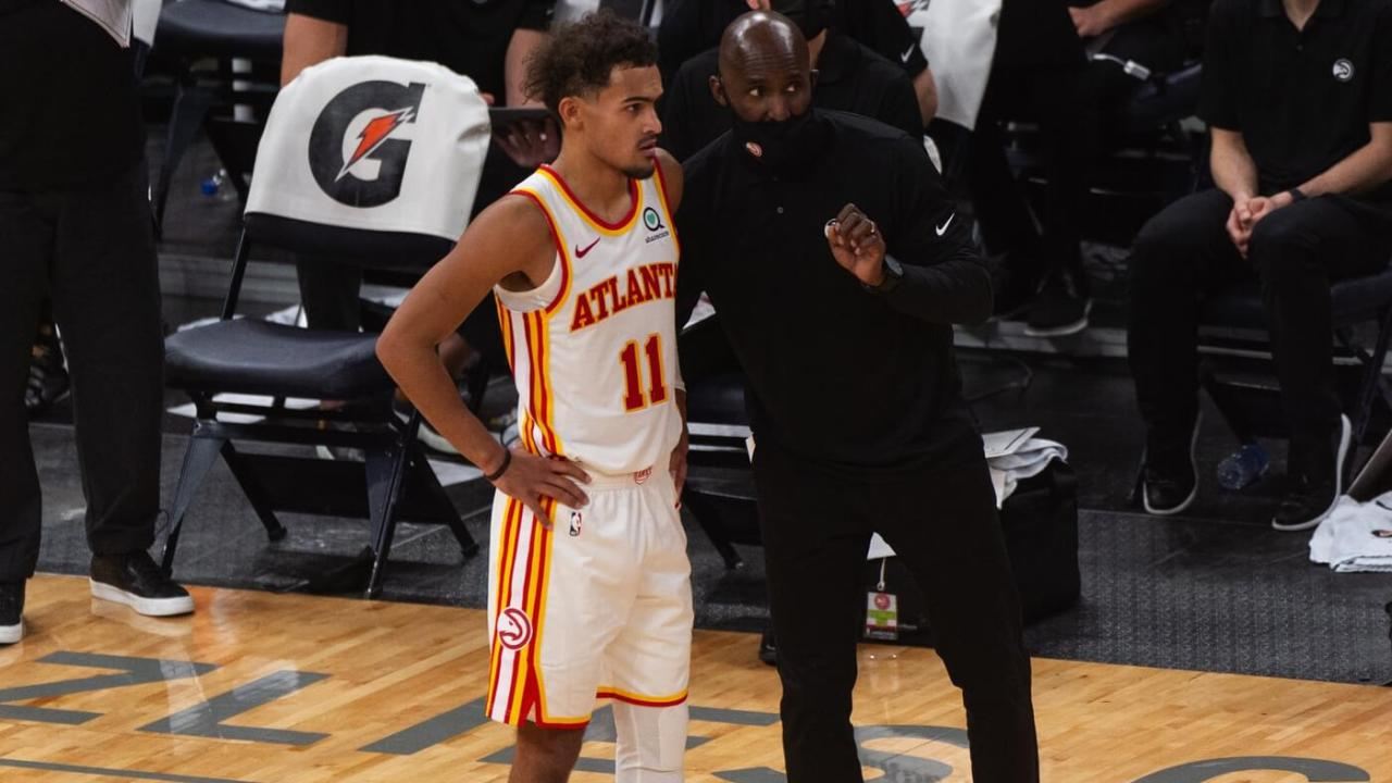 Dec 26, 2020; Memphis, Tennessee, USA; Atlanta Hawks guard Trae Young (11) and Atlanta Hawks head coach Lloyd Pierce during the second half against the Memphis Grizzlies at FedExForum. Mandatory Credit: Justin Ford-USA TODAY Sports