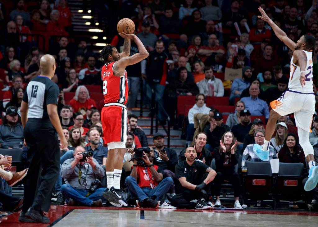 Mar 10, 2020; Portland, OR, USA; Portland Trail Blazers forward Trevor Ariza (8) shoots over Phoenix Suns forward Mikal Bridges (25) during the third quarter at the Moda Center. Mandatory Credit: Craig Mitchelldyer-USA TODAY Sports