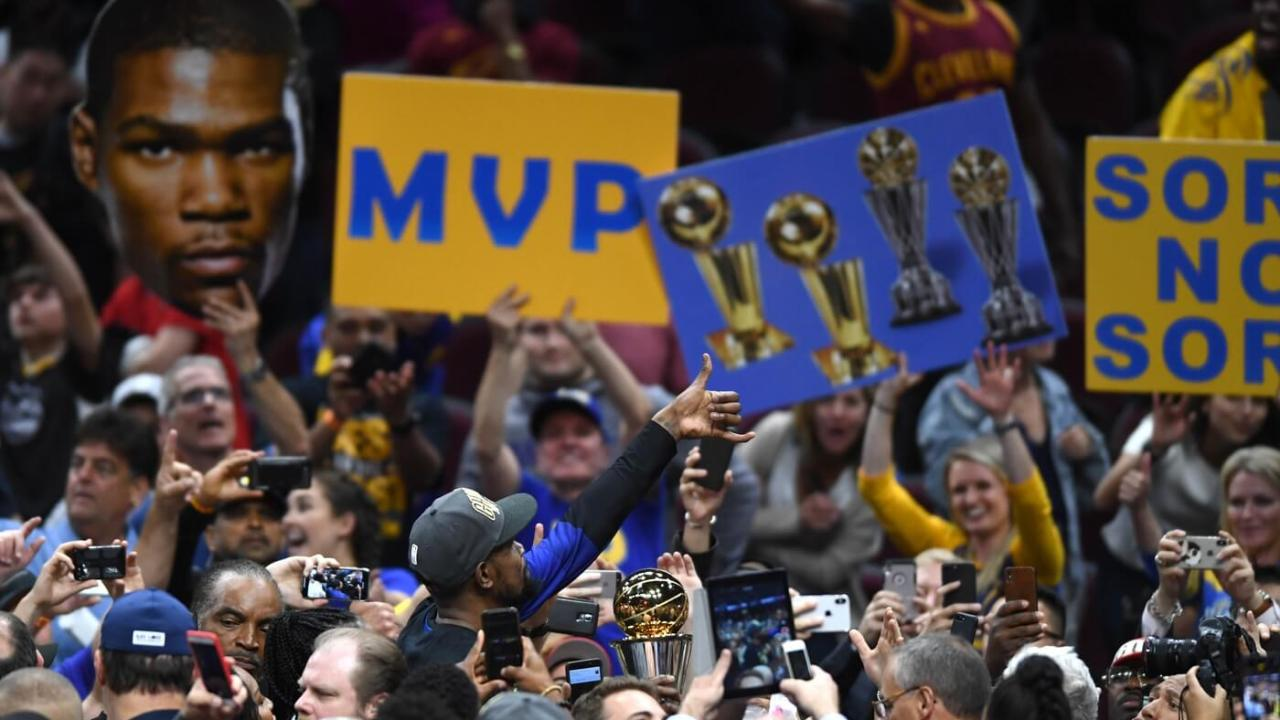 Jun 8, 2018; Cleveland, OH, USA; Golden State Warriors forward Kevin Durant (middle) holds the Bill Russell NBA Finals Most Valuable Player Award after defiant the Cleveland Cavaliers in game four of the 2018 NBA Finals at Quicken Loans Arena.