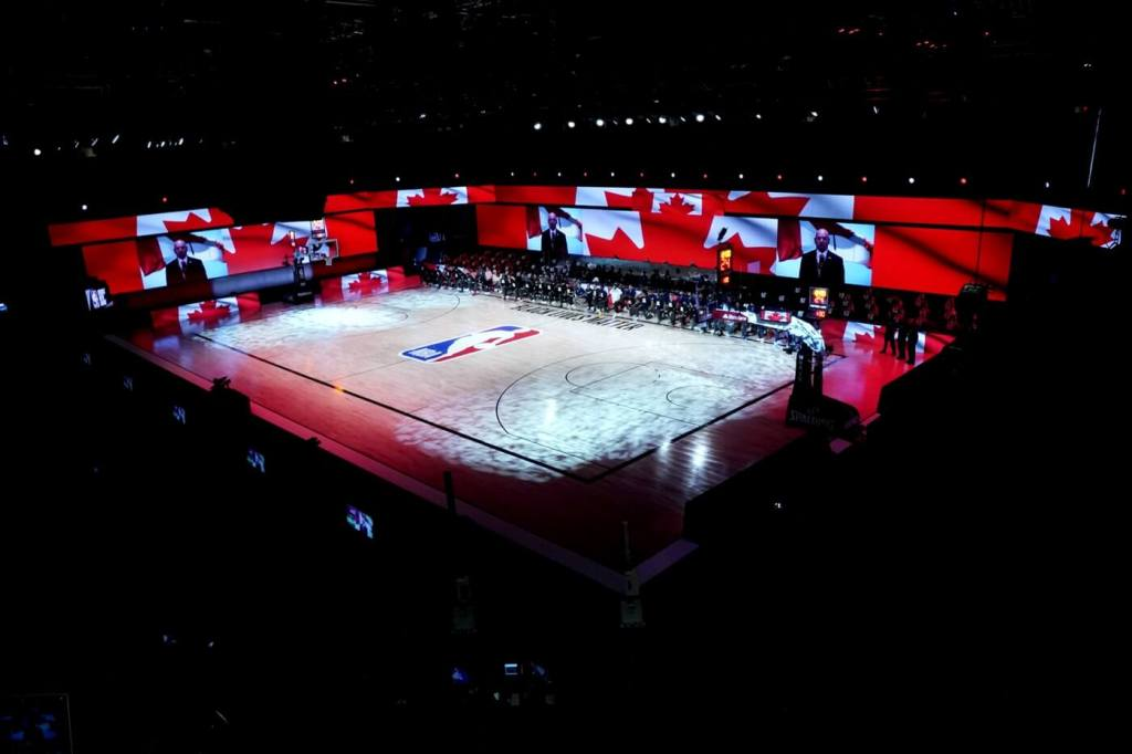 Aug 7, 2020; Lake Buena Vista, Florida, USA; The Canada flag is projected on the video boards during the playing of the Canadian national anthem prior to an NBA basketball game between the Boston Celtics and the Toronto Raptors at The Arena. Mandatory Credit: Ashley Landis/Pool Photo-USA TODAY Sports