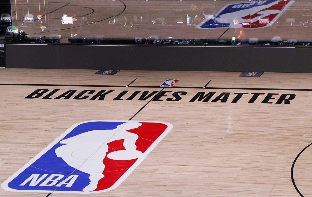 An empty court and bench is shown with no signage following the scheduled start time in Game Five of the Eastern Conference First Round between the Milwaukee Bucks and the Orlando Magic during the 2020 NBA Playoffs at AdventHealth Arena at ESPN Wide World Of Sports Complex on August 26, 2020 in Lake Buena Vista, Florida. The Milwaukee Buck have boycotted game 5 reportedly to protest the shooting of Jacob Blake in Kenosha, Wisconsin