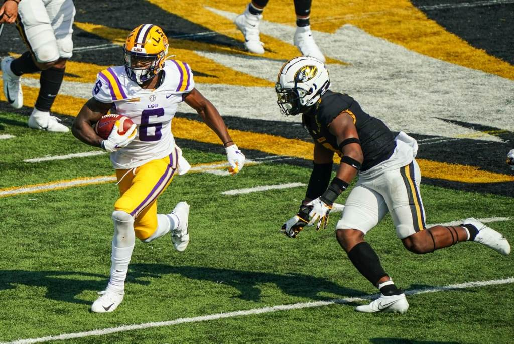 LSU Tigers wide receiver Terrace Marshall Jr. (6) runs against Missouri Tigers safety Martez Manuel (3) during the second half at Faurot Field at Memorial Stadium.