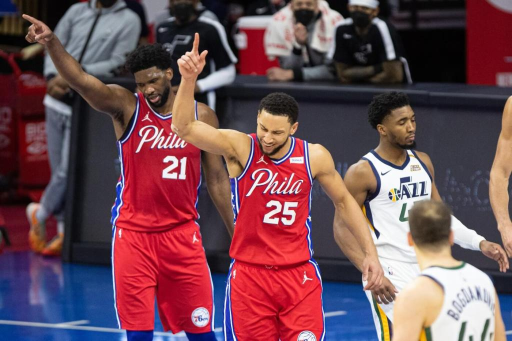Mar 3, 2021; Philadelphia, Pennsylvania, USA; Philadelphia 76ers guard Ben Simmons (25) and center Joel Embiid (21) reacts in front of Utah Jazz guard Donovan Mitchell (45) after a turnover during overtime at Wells Fargo Center. Mandatory Credit: Bill Streicher-USA TODAY Sports