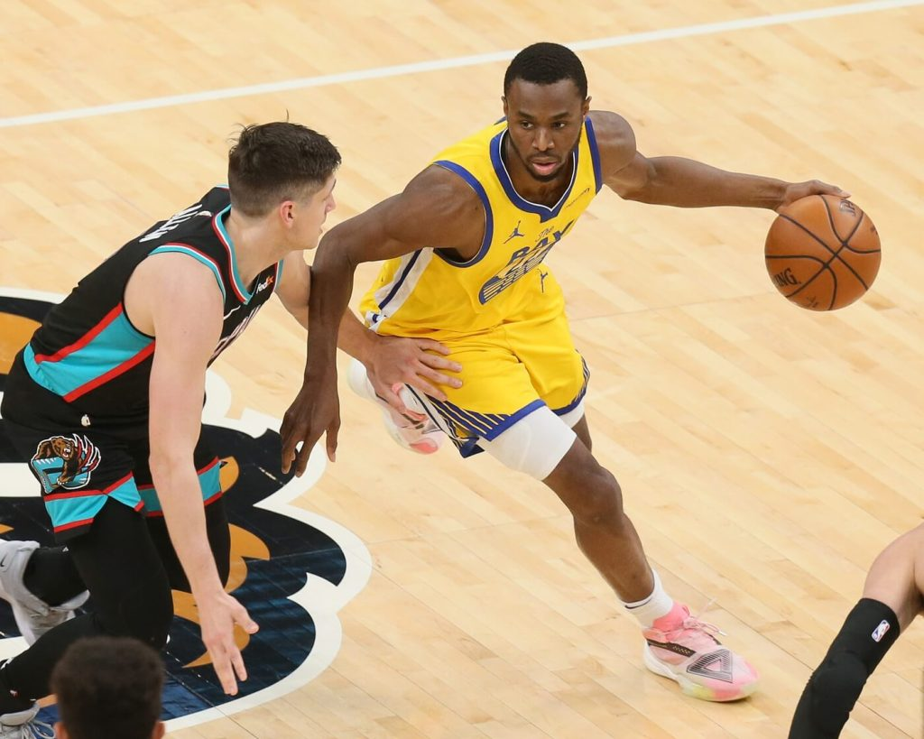 Mar 20, 2021; Memphis, Tennessee, USA; Golden State Warriors forward Andrew Wiggins (22) drives against Memphis Grizzlies guard Grayson Allen (3) during the third quarter at FedExForum. Mandatory Credit: Nelson Chenault-USA TODAY