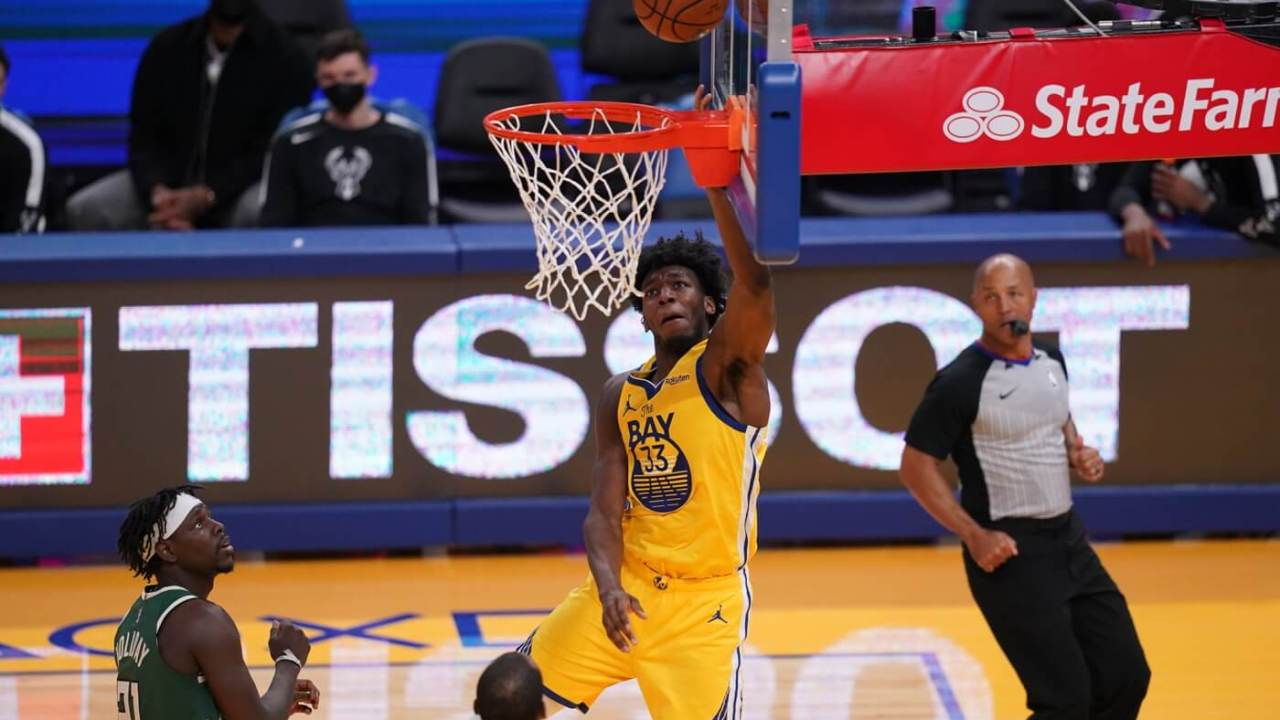 Apr 6, 2021; San Francisco, California, USA; Golden State Warriors center James Wiseman (33) makes a layup against the Milwaukee Bucks in the second quarter at the Chase Center. Mandatory Credit: Cary Edmondson-USA TODAY Sports