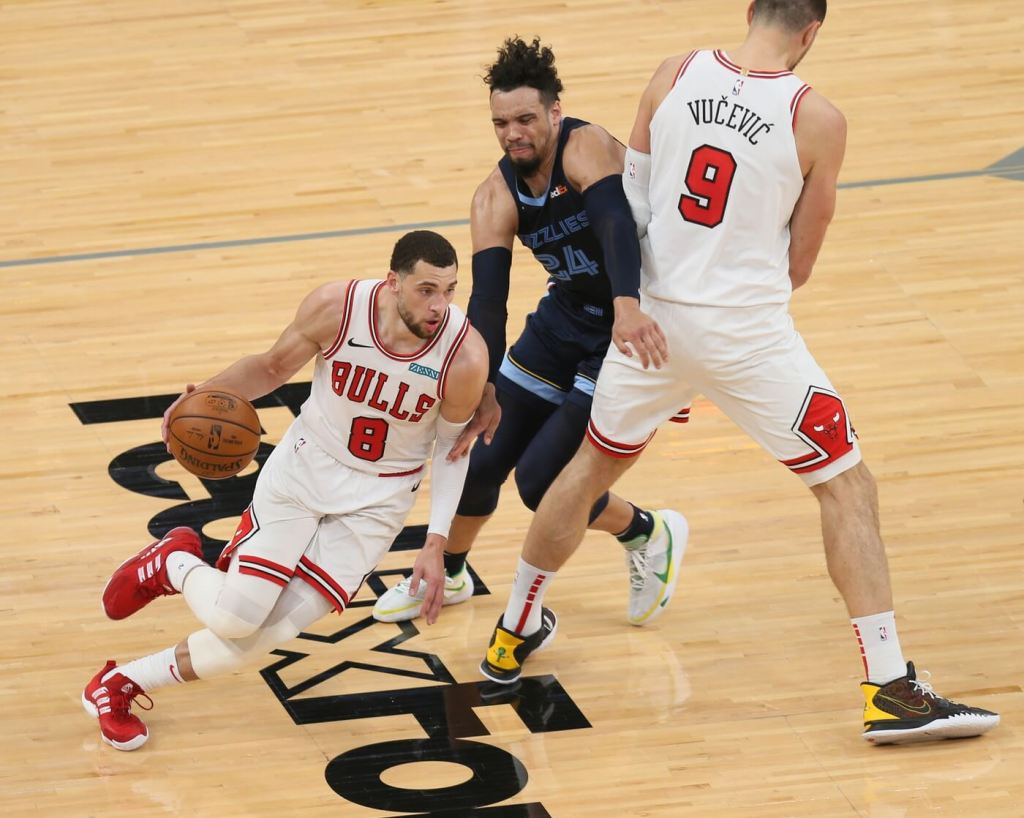 Apr 12, 2021; Memphis, Tennessee, USA; Chicago Bulls guard Zach LaVine (8) dribbles around a pick by center Nikola Vucevic (9) on Memphis Grizzlies forward Dylan Brooks (24) during the first half at FedExForum. Mandatory Credit: Nelson Chenault-USA TODAY Sports