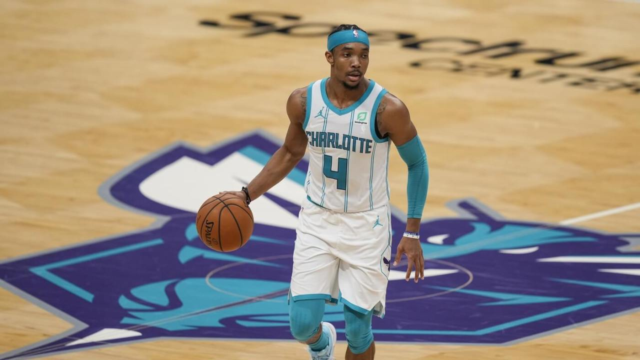 Apr 14, 2021; Charlotte, North Carolina, USA; Charlotte Hornets guard Devonte' Graham (4) handles the ball during the second half against the Cleveland Cavaliers at the Spectrum Center. Mandatory Credit: Jim Dedmon-USA TODAY Sports