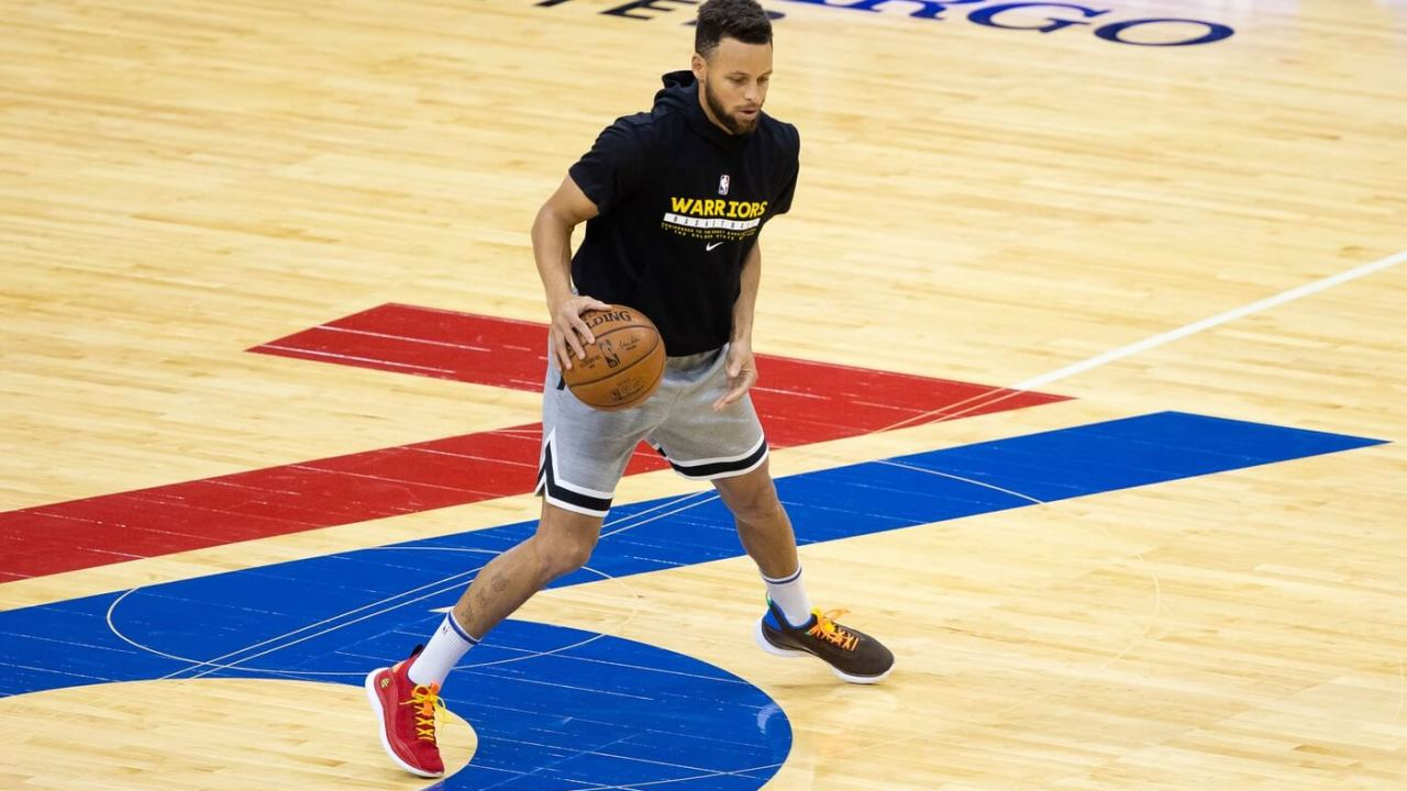 Apr 19, 2021; Philadelphia, Pennsylvania, USA; Golden State Warriors guard Stephen Curry (30) warms up before a game against the Philadelphia 76ers at Wells Fargo Center.
