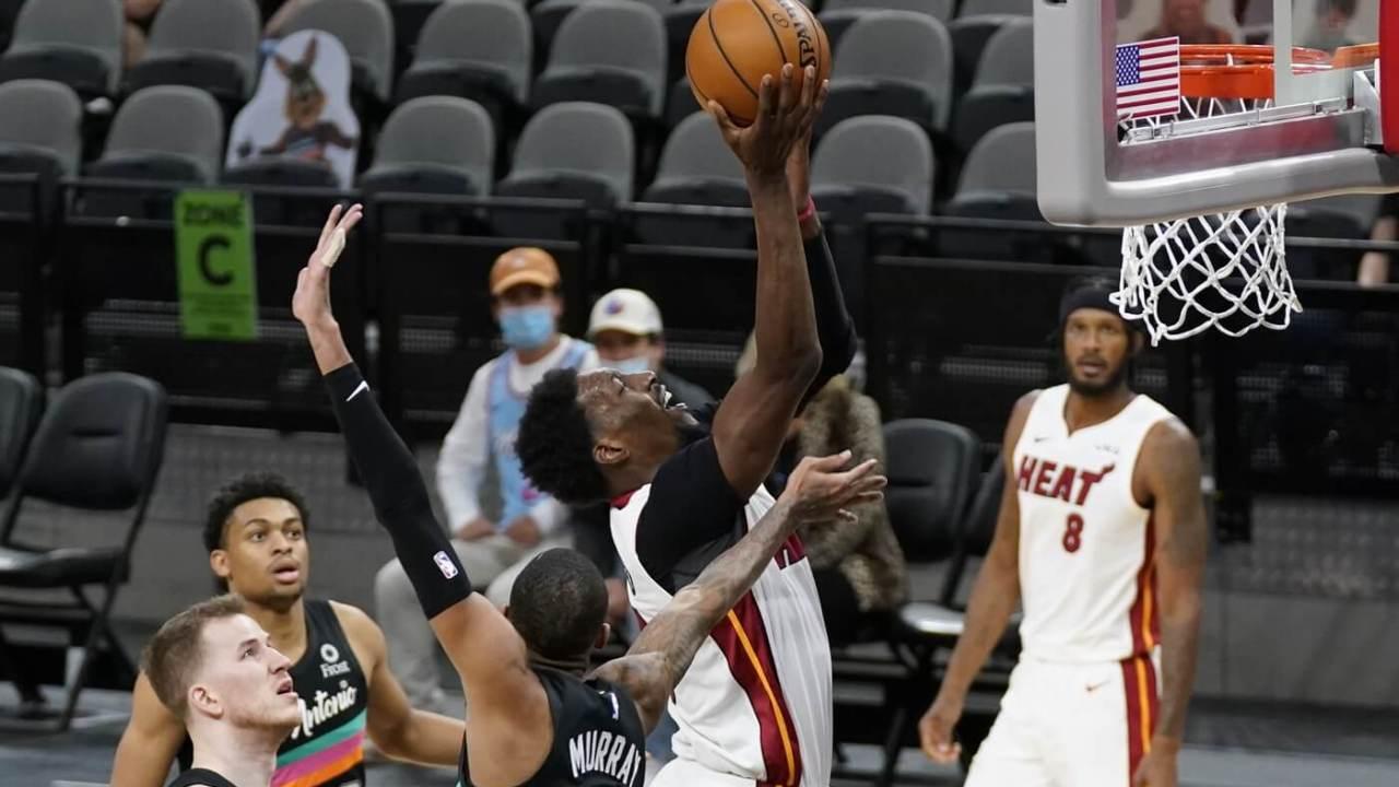 Apr 21, 2021; San Antonio, Texas, USA; Miami Heat center Bam Adebayo (13) shoots the ball against San Antonio Spurs guard Dejounte Murray (5) in the third quarter at AT&T Center. Mandatory Credit: Scott Wachter-USA TODAY Sports