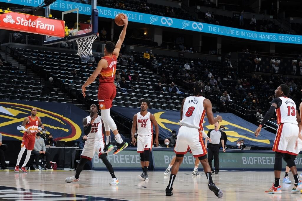 DENVER, CO - APRIL 14: Michael Porter Jr. #1 of the Denver Nuggets dunks the ball against the Miami Heat on April 14, 2021 at the Ball Arena in Denver, Colorado. NOTE TO USER: User expressly acknowledges and agrees that, by downloading and/or using this Photograph, user is consenting to the terms and conditions of the Getty Images License Agreement. Mandatory Copyright Notice: Copyright 2021 NBAE (Photo by Bart Young/NBAE via Getty Images)