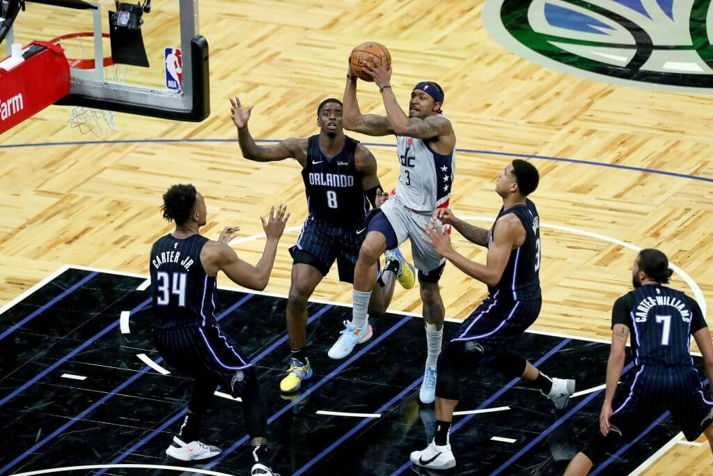 ORLANDO, FL - APRIL 07: Bradley Beal #3 of the Washington Wizards drives to the net in front of Wendell Carter Jr. #34, Dwayne Bacon #8, Chuma Okeke #3 and Michael Carter-Williams #7 of the Orlando Magic during the second half at Amway Center on April 7, 2021 in Orlando, Florida. NOTE TO USER: User expressly acknowledges and agrees that, by downloading and or using this photograph, User is consenting to the terms and conditions of the Getty Images License Agreement. (Photo by Alex Menendez/Getty Images)