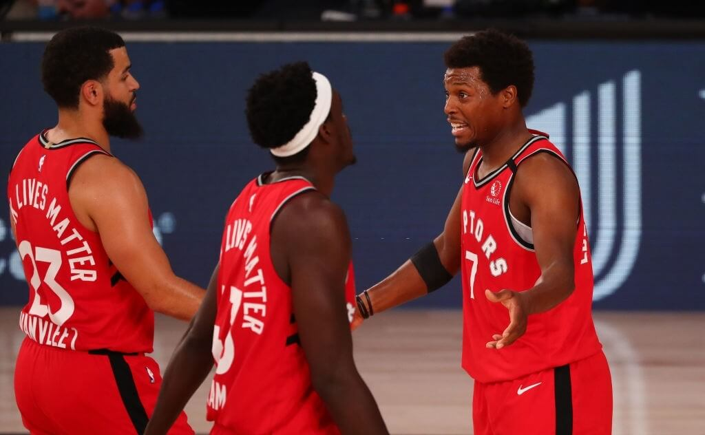 LAKE BUENA VISTA, FLORIDA - AUGUST 05:  Kyle Lowry#7, Fred VanVleet #23 and Pascal Siakam #43 of the Toronto Raptors talk during a break in the first half against the Orlando Magic at Visa Athletic Center at ESPN Wide World Of Sports Complex on August 5, 2020 in Lake Buena Vista, Florida. NOTE TO USER: User expressly acknowledges and agrees that, by downloading and or using this photograph, User is consenting to the terms and conditions of the Getty Images License Agreement. (Photo by Kim Klement-Pool/Getty Images)