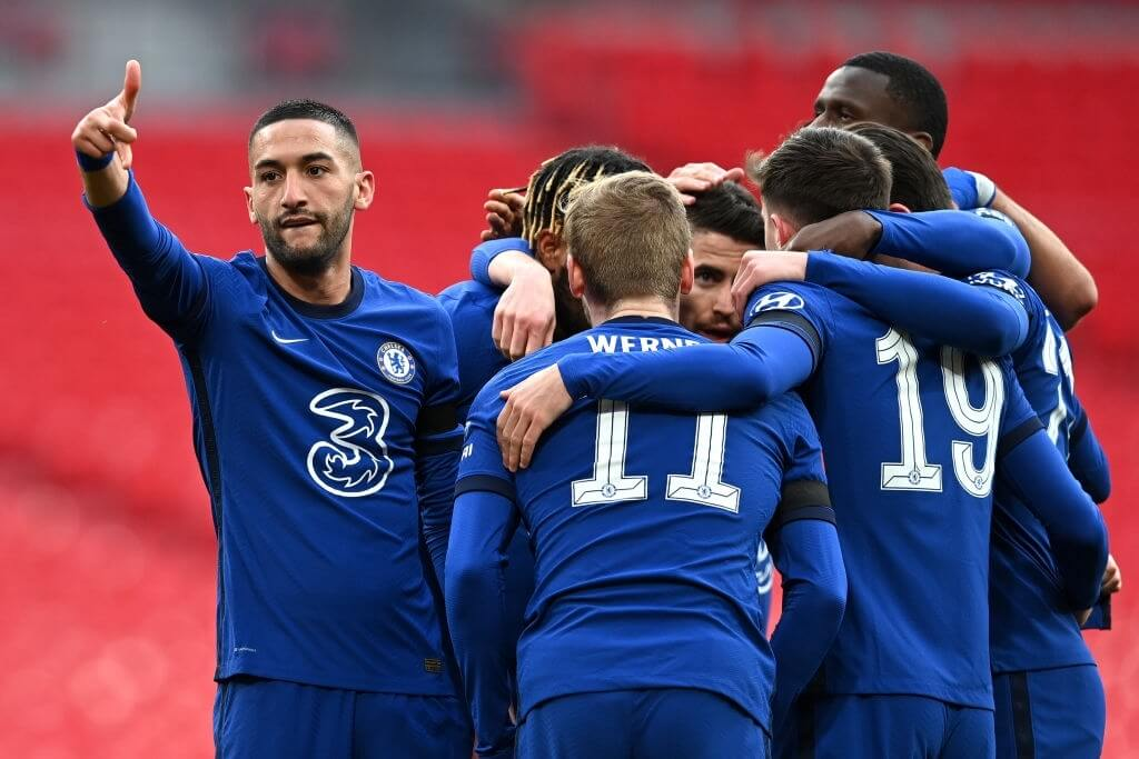 LONDON, ENGLAND - APRIL 17: Hakim Ziyech of Chelsea celebrates with teammates after scoring their team's first goal during the Semi Final of the Emirates FA Cup match between Manchester City and Chelsea FC at Wembley Stadium on April 17, 2021 in London, England. Sporting stadiums around the UK remain under strict restrictions due to the Coronavirus Pandemic as Government social distancing laws prohibit fans inside venues resulting in games being played behind closed doors.