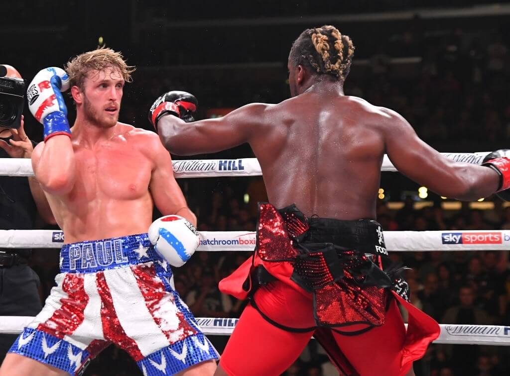 LOS ANGELES, CA - NOVEMBER 09: Logan Paul (red/white/blue shorts) and KSI (black/red shorts) exchange punches their pro debut fight at Staples Center on November 9, 2019 in Los Angeles, California. KSI won by decision. (Photo by Jayne Kamin-Oncea/Getty Images)