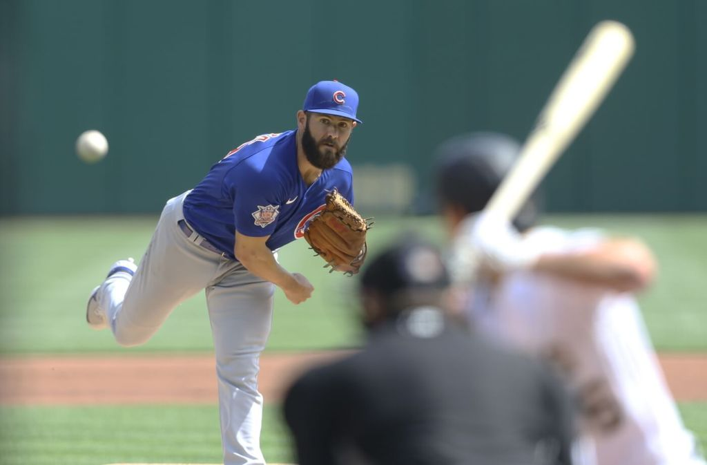 Apr 8, 2021; Pittsburgh, Pennsylvania, USA; Chicago Cubs starting pitcher Jake Arrieta (49) delivers a pitch to Pittsburgh Pirates second baseman Adam Frazier (26) during the first inning at PNC Park. Mandatory Credit: Charles LeClaire-USA TODAY Sports