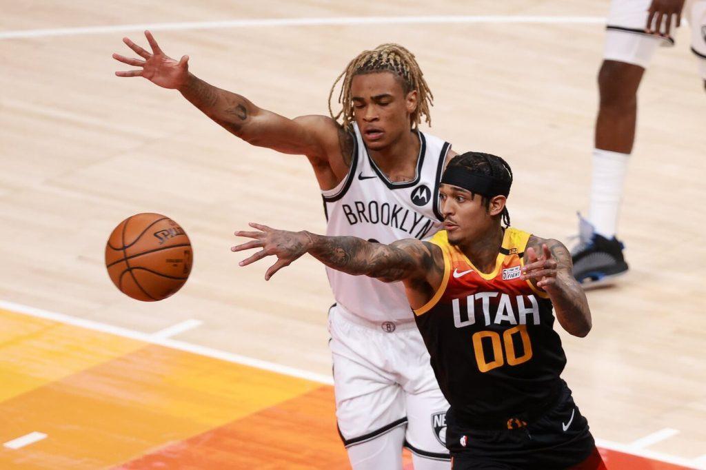 Mar 24, 2021; Salt Lake City, Utah, USA; Utah Jazz guard Jordan Clarkson (00) passes the ball away from Brooklyn Nets forward Nicolas Claxton (33) during the second quarter at Vivint Smart Home Arena. Mandatory Credit: Chris Nicoll-USA TODAY Sports