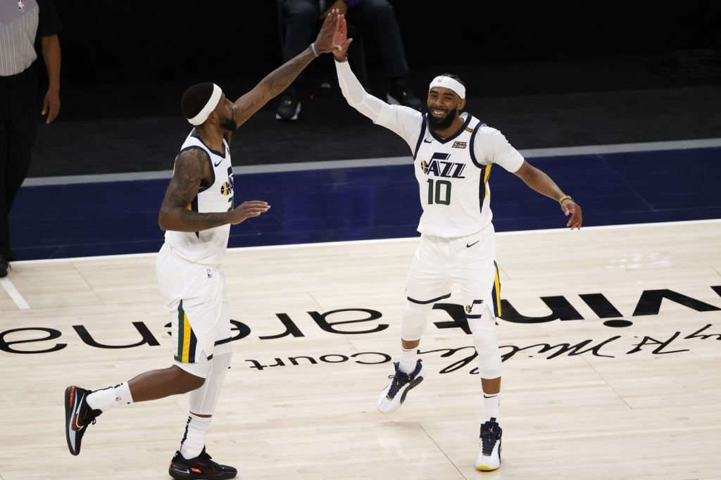 Apr 10, 2021; Salt Lake City, Utah, USA; Utah Jazz guard Mike Conley (10) reacts with forward Royce O'Neale (23) after hitting a three-pointer in the fourth quarter against the Sacramento Kings at Vivint Smart Home Arena. Mandatory Credit: Jeffrey Swinger-USA TODAY Sports
