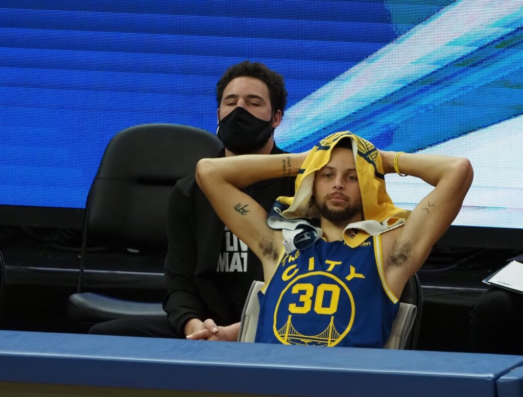 Jan 21, 2021; San Francisco, California, USA; Golden State Warriors guard Stephen Curry (30) on the bench ahead of guard Klay Thompson (11) during the fourth quarter against the New York Knicks at Chase Center. Mandatory Credit: Kelley L Cox-USA TODAY Sports