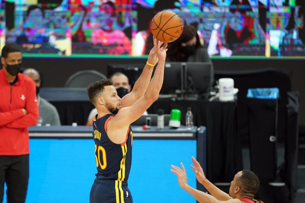 Apr 10, 2021; San Francisco, California, USA; Golden State Warriors guard Stephen Curry (30) shoots a 3-pointer during the third quarter against the Houston Rockets at Chase Center. Mandatory Credit: Darren Yamashita-USA TODAY Sports