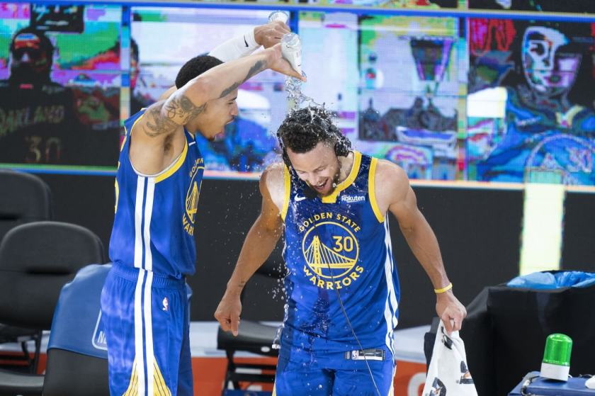 April 12, 2021; San Francisco, California, USA; Golden State Warriors forward Juan Toscano-Anderson (95) pours water on guard Stephen Curry (30) after the game against the Denver Nuggets at Chase Center. Mandatory Credit: Kyle Terada-USA TODAY Sports