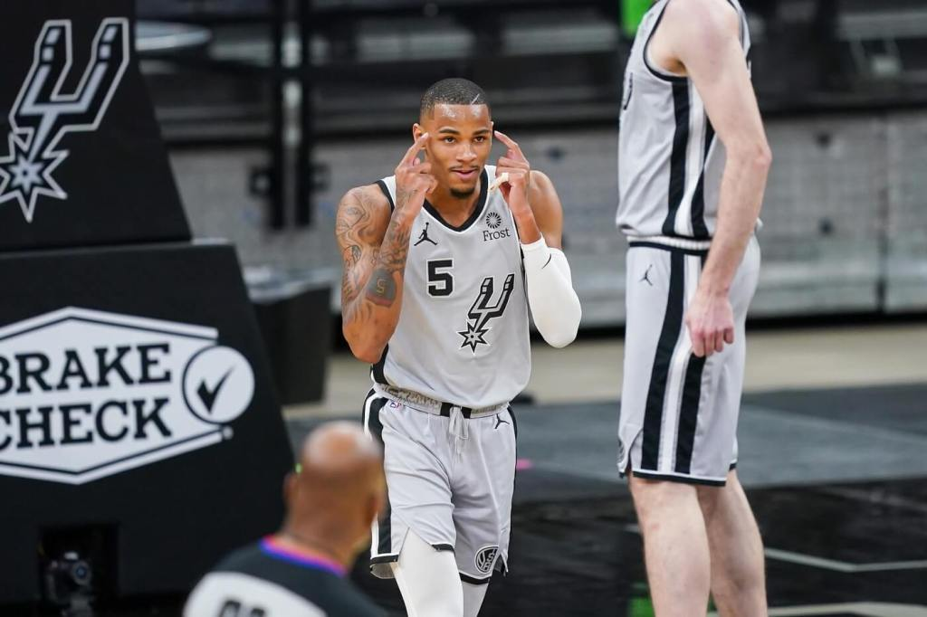 Mar 29, 2021; San Antonio, Texas, USA; San Antonio Spurs guard Dejounte Murray (5) reacts in the first half against the Sacramento Kings at the AT&T Center. Mandatory Credit: Daniel Dunn-USA TODAY Sports