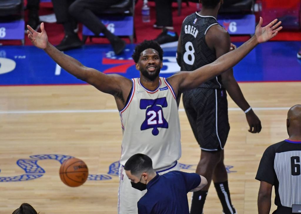 Apr 14, 2021; Philadelphia, Pennsylvania, USA; Philadelphia 76ers center Joel Embiid (21) celebrates after making a basket and drawing a foul against the Brooklyn Nets during the third quarter at Wells Fargo Center. Mandatory Credit: Eric Hartline-USA TODAY Sports