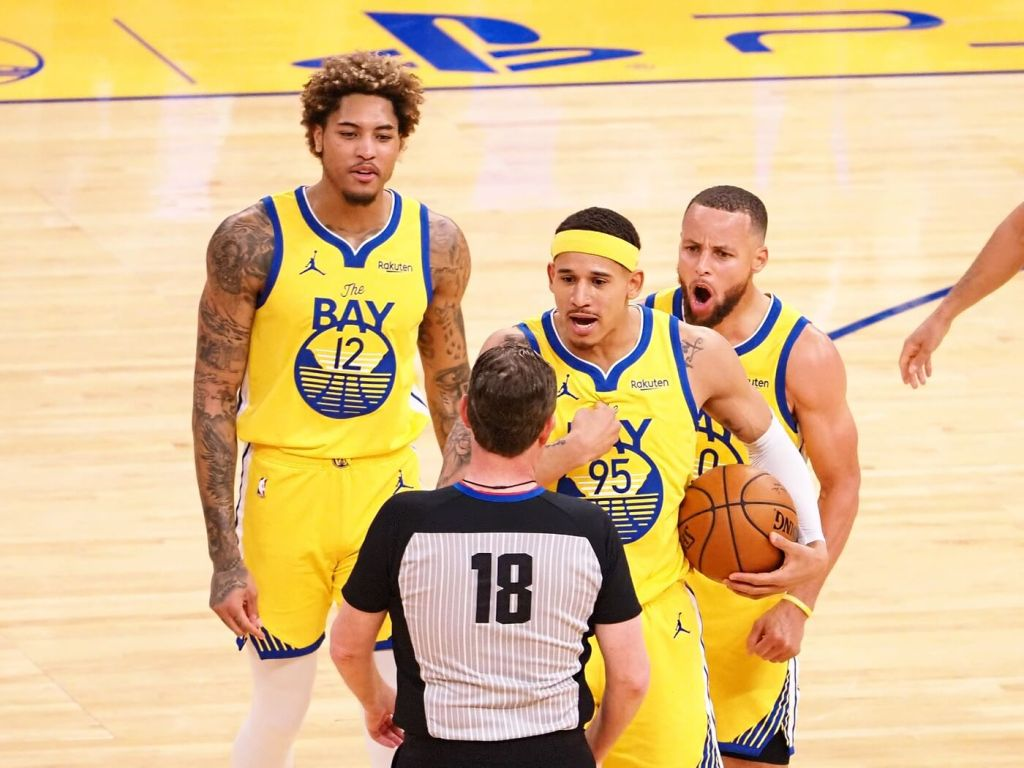 Apr 23, 2021; San Francisco, California, USA; Golden State Warriors guard Mychal Mulder (15) and guard Stephen Curry (30) argue a call with forward-guard Kelly Oubre Jr. (12) to referee Matt Boland (18) as Curry is called for a technical foul during the third quarter against the Denver Nuggets at Chase Center. Mandatory Credit: Kelley L Cox-USA TODAY Sports