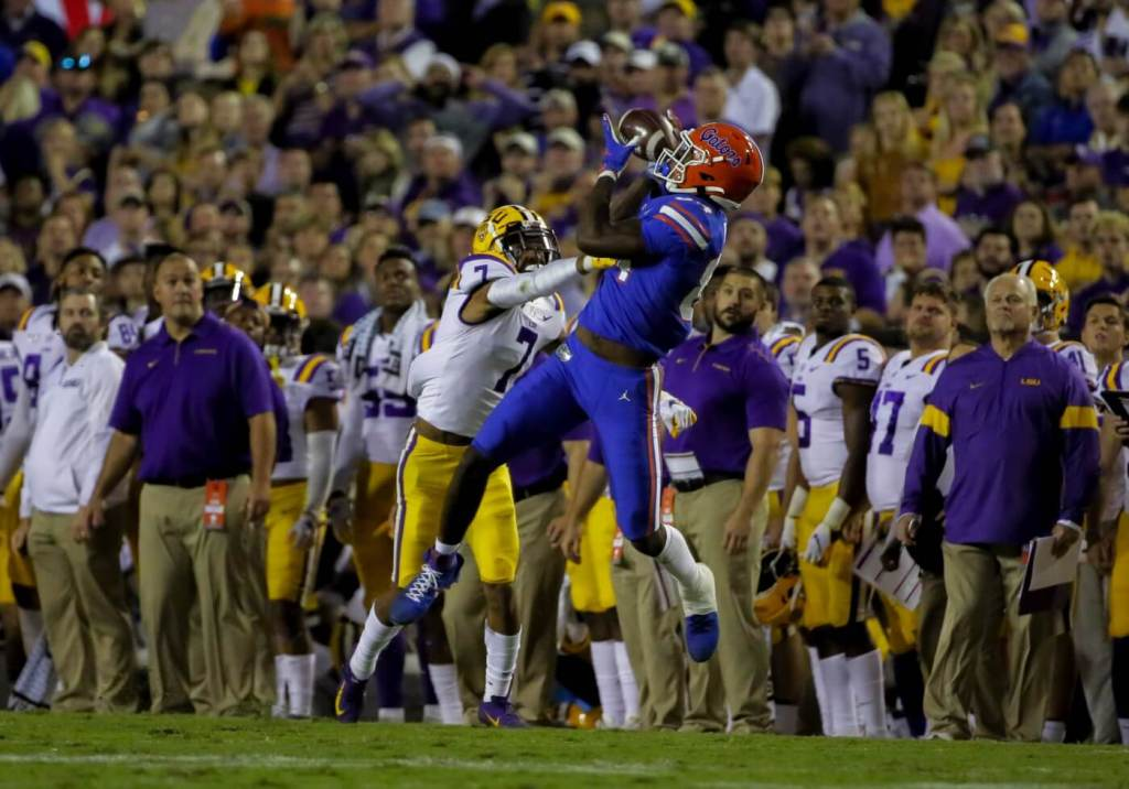 Oct 12, 2019; Baton Rouge, LA, USA; Florida Gators tight end Kyle Pitts (84) catches a pass over LSU Tigers safety Grant Delpit (7) during the first half at Tiger Stadium. Mandatory Credit: Derick E. Hingle-USA TODAY Sports