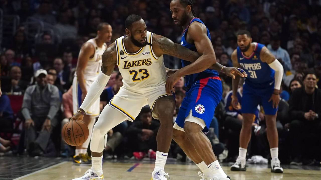 Mar 8, 2020; Los Angeles, California, USA; Los Angeles Lakers forward LeBron James (23) is defended by LA Clippers forward Kawhi Leonard (2) in the second half at Staples Center. The Lakers defeated the Clippers 112-100. Mandatory Credit: Kirby Lee-USA TODAY Sports
