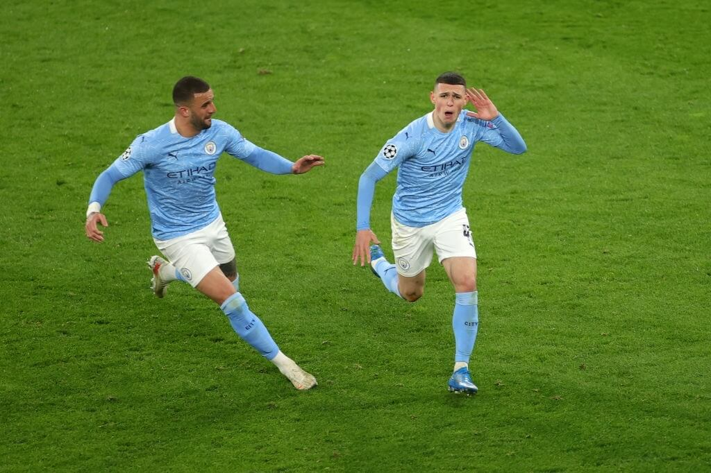 DORTMUND, GERMANY - APRIL 14: Phil Foden of Manchester City celebrates with team mate Kyle Walker after scoring their side's second goal during the UEFA Champions League Quarter Final Second Leg match between Borussia Dortmund and Manchester City at Signal Iduna Park on April 14, 2021 in Dortmund, Germany. Sporting stadiums around Germany remain under strict restrictions due to the Coronavirus Pandemic as Government social distancing laws prohibit fans inside venues resulting in games being played behind closed doors.