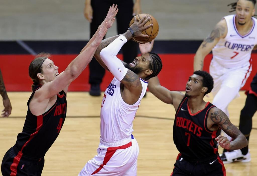 Apr 23, 2021; Houston, Texas, USA; Paul George #13 of the Los Angeles Clippers looks to shoot against Kelly Olynyk #41 and Armoni Brooks #7 of the Houston Rockets during the second quarter at Toyota Center. Mandatory Credit: Carmen Mandato/POOL PHOTOS-USA TODAY Sports