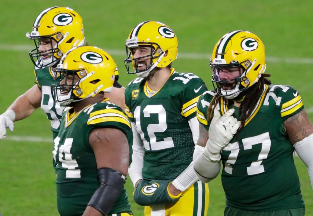QB Aaron Rodgers (12) and the Packers were all smiles Saturday night after dispatching the Rams. 2021-01-17-rodgers-packers