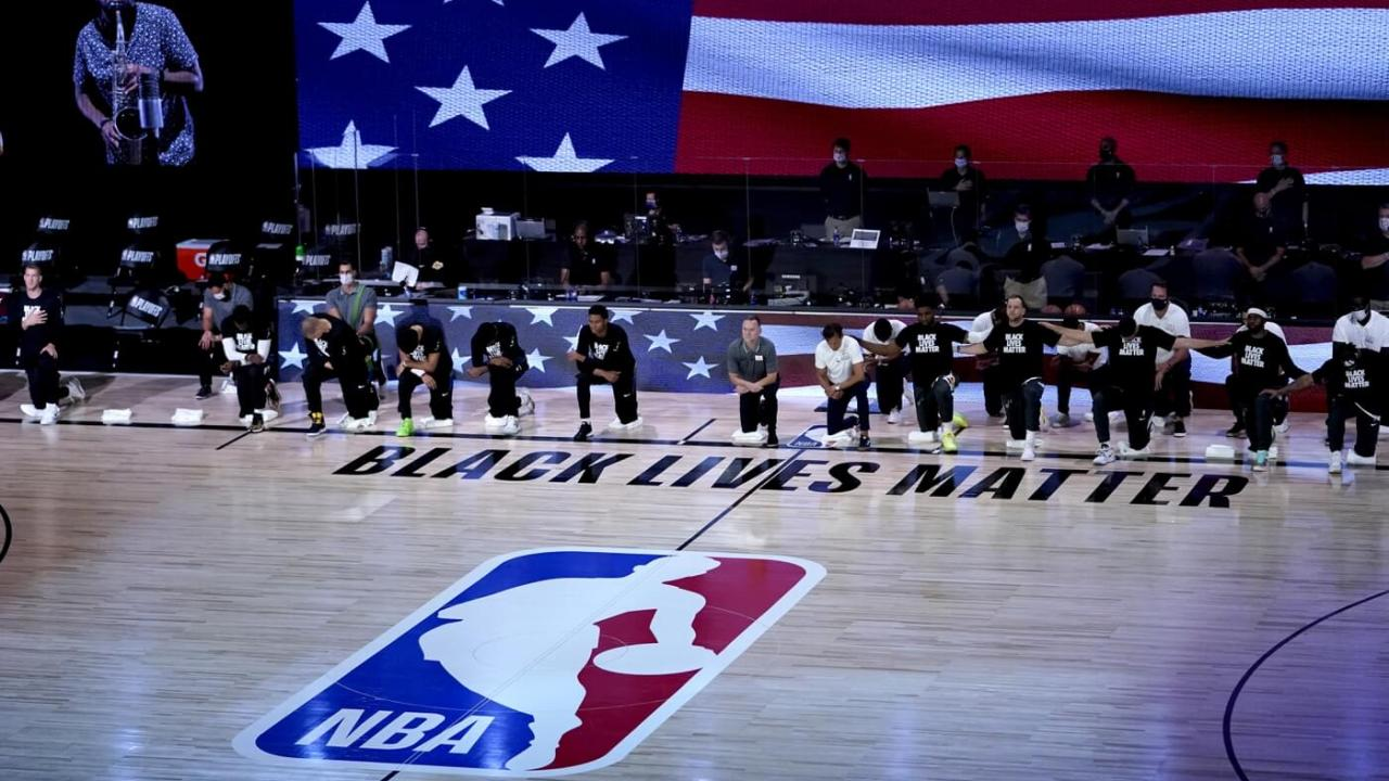 Aug 17, 2020; Orlando, Florida, USA; Players kneel in honor of the Black Lives Matter movement during the playing of the national anthem prior to game one of the first round of the 2020 NBA Playoffs at The Field House. Mandatory Credit: Ashley Landis/Pool Photo-USA TODAY Sports