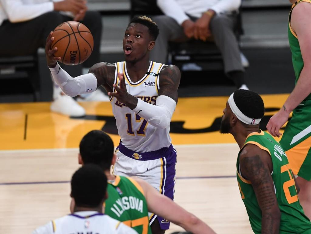 Apr 17, 2021; Los Angeles, California, USA; Los Angeles Lakers guard Dennis Schroder (17) goes up for a basket in the second half of the game against the Utah Jazz at Staples Center. Mandatory Credit: Jayne Kamin-Oncea-USA TODAY Sports