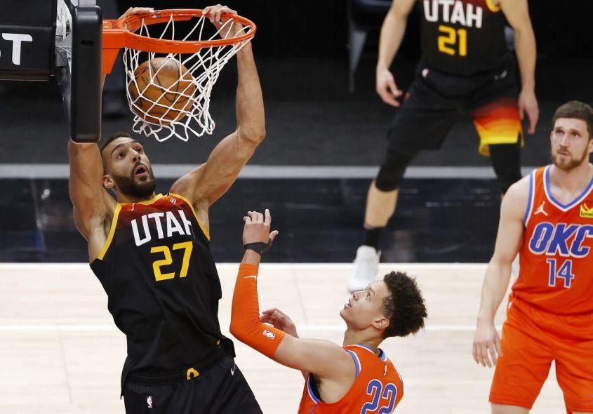 Apr 13, 2021; Salt Lake City, Utah, USA; Utah Jazz center Rudy Gobert (27) dunks over Oklahoma City Thunder center Isaiah Roby (22) in the fourth quarter at Vivint Smart Home Arena. Mandatory Credit: Jeffrey Swinger-USA TODAY Sports