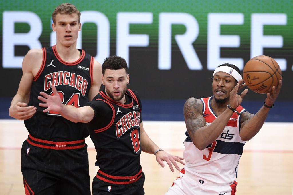 Dec 29, 2020; Washington, District of Columbia, USA; Washington Wizards guard Bradley Beal (3) controls the ball against Chicago Bulls guard Zach LaVine (8) and forward Lauri Markkanen (24) during the first half at Capital One Arena. Mandatory Credit: POOL PHOTOS-USA TODAY Sports