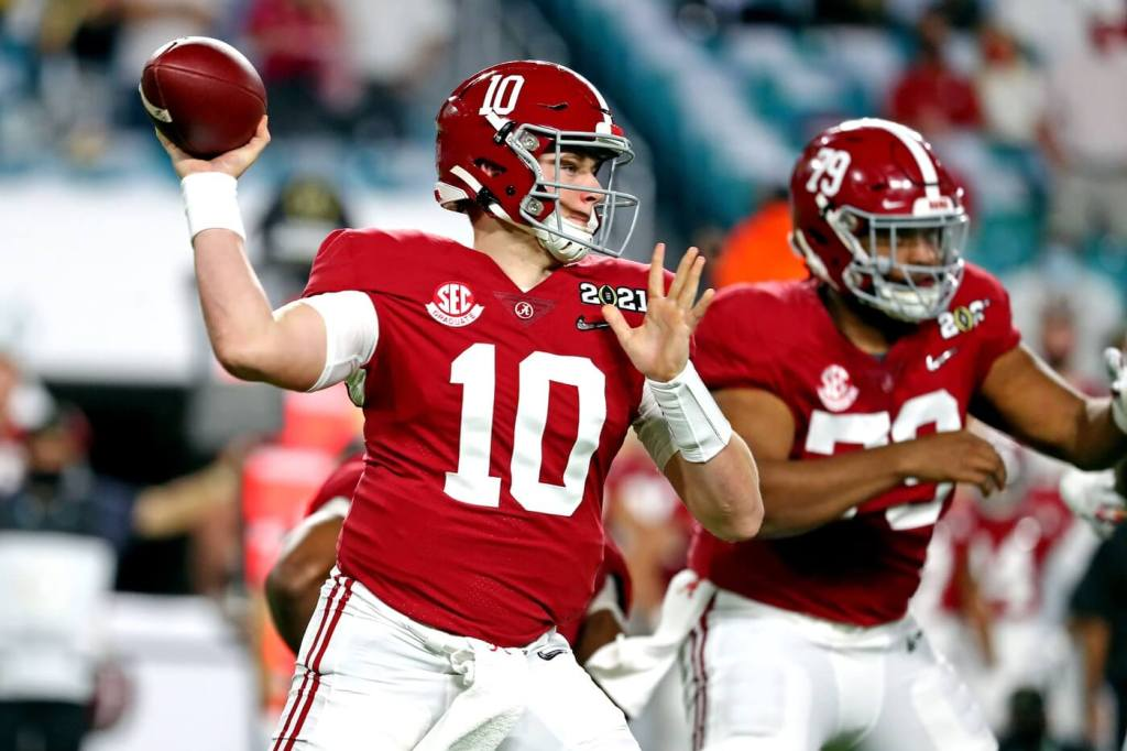 Jan 11, 2021; Miami Gardens, Florida, USA; Alabama Crimson Tide quarterback Mac Jones (10) throws a pass during the first quarter against the Ohio State Buckeyes in the 2021 College Football Playoff National Championship Game. Mandatory Credit: Kim Klement-USA TODAY Sports