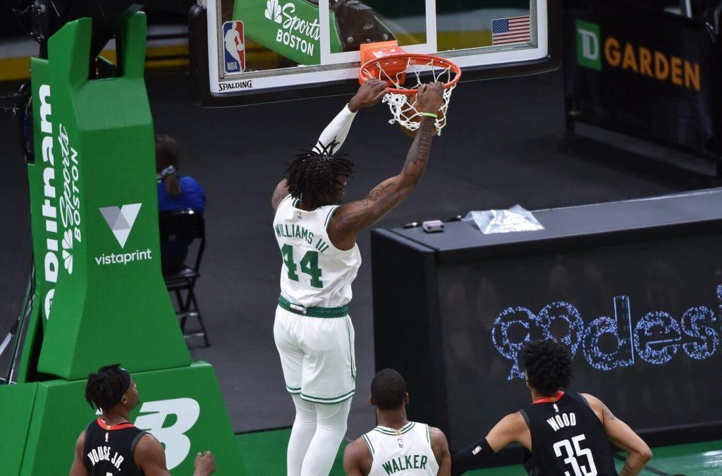 Apr 2, 2021; Boston, Massachusetts, USA; Boston Celtics center Robert Williams III (44) dunks the ball during the first half against the Houston Rockets at TD Garden. Mandatory Credit: Bob DeChiara-USA TODAY Sports