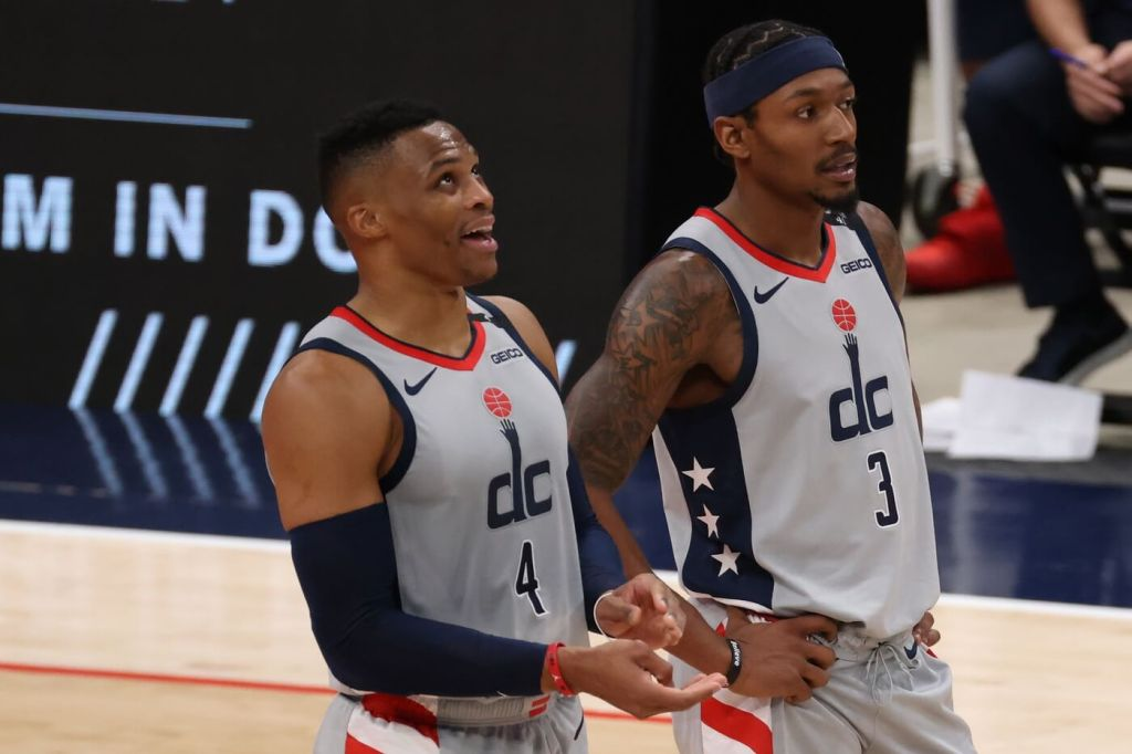 Dec 26, 2020; Washington, District of Columbia, USA; Washington Wizards guard Russell Westbrook (4) stands on the court with Wizards guard Bradley Beal (3) against the Orlando Magic in the second quarter at Capital One Arena. Mandatory Credit: Geoff Burke-USA TODAY Sports