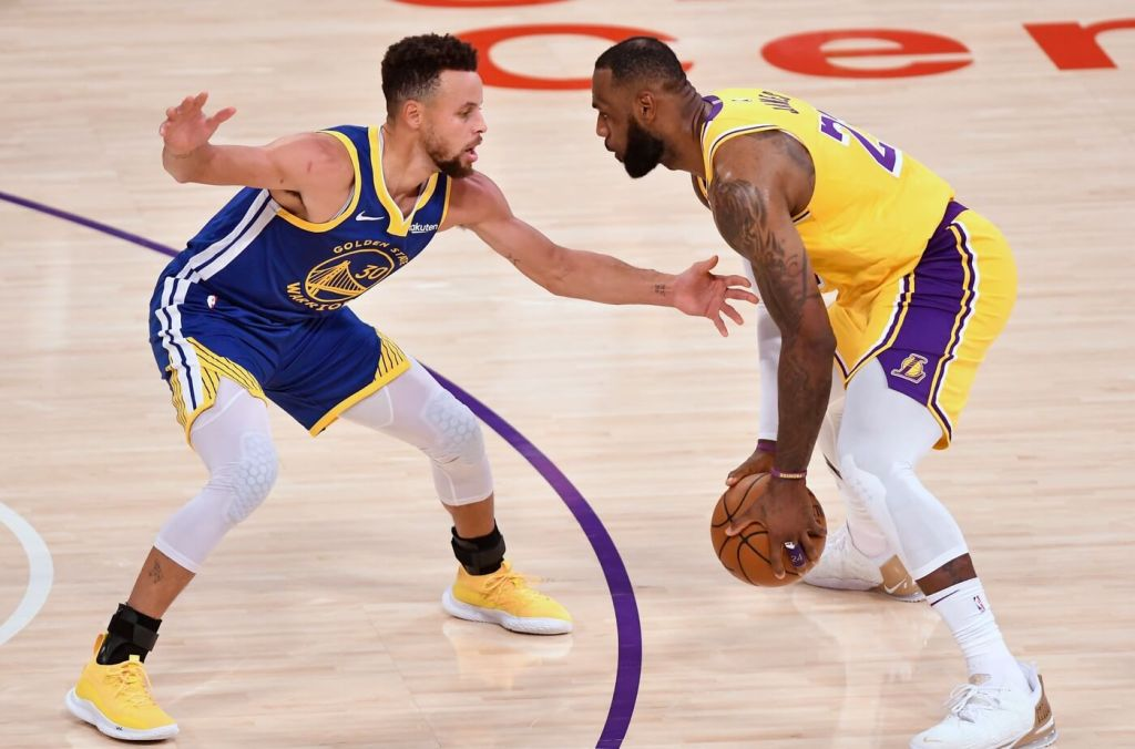 Jan 18, 2021; Los Angeles, California, USA; Golden State Warriors guard Stephen Curry (30) defends Los Angeles Lakers forward LeBron James (23) during the second quarter at Staples Center. Mandatory Credit: Robert Hanashiro-USA TODAY Sports